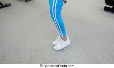 beautiful woman jumping rope in the gym - sexy woman jumping...