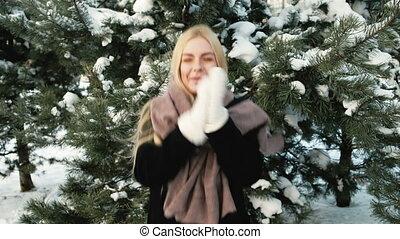 Beautiful woman jumps on frost to get warmed, winter landscape