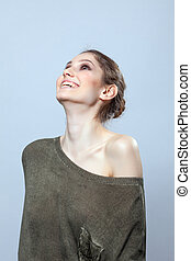 Beautiful woman laughing in studio