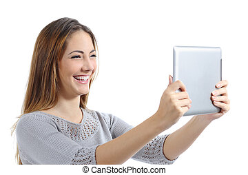Beautiful woman laughing watching a digital tablet
