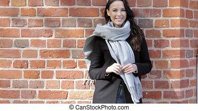 Beautiful woman leaning on brick wall - Beautiful woman in...