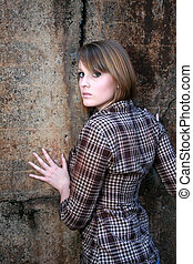 Beautiful woman leaning on wall