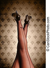 Beautiful woman legs in stockings on vintage background