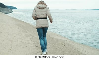 Beautiful woman legs, running along the beach. Leaving...