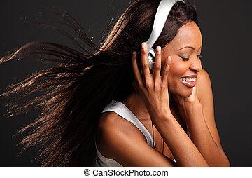 Beautiful woman listening to music - Headshot of beautiful...