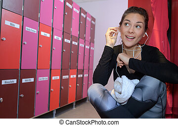 beautiful woman listening to music in changing room