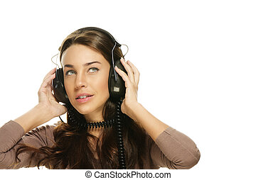 beautiful woman listening to music looking up on white background