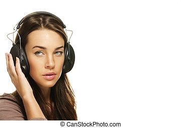 beautiful woman listening to music on white background