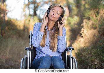 beautiful woman listening to music outside