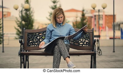 Beautiful woman looking at photo album