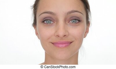 Beautiful woman looking at the camera and smiling