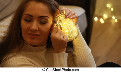 Beautiful woman looking at the lights, closes her eyes,...