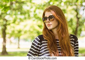 Beautiful woman looking away in park