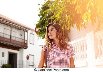 Beautiful woman looking away while walking