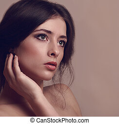 Beautiful woman looking dramatic. Vintage closeup portrait