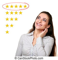 Beautiful woman looking up and choose five stars rating in...