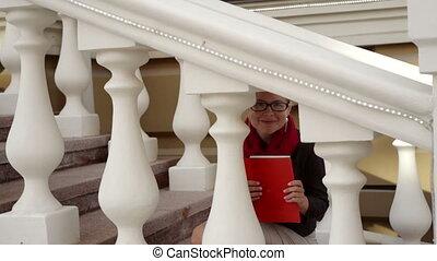 Beautiful woman looks across stair railings in city