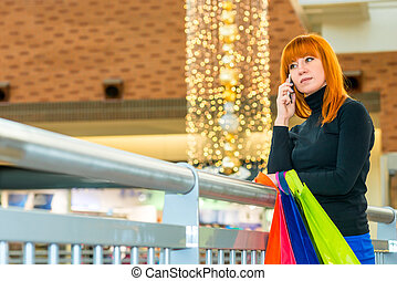 beautiful woman lost in thought at the mall