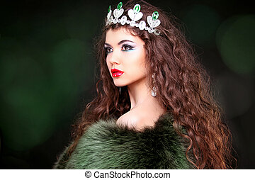 Beautiful woman luxury portrait with long hair in fur coat. Jewelry and Beauty. Fashion art photo