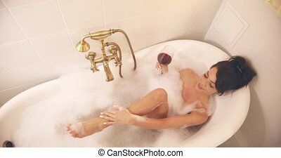 Beautiful woman lying and taking bath - From above pretty...