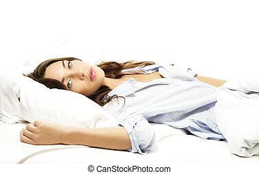 beautiful woman lying in bed on white background