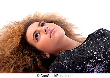 Beautiful woman lying, isolated on white background, studio shot