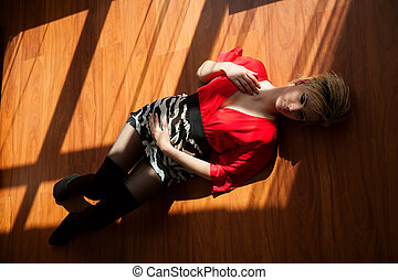 Beautiful woman lying on a floor