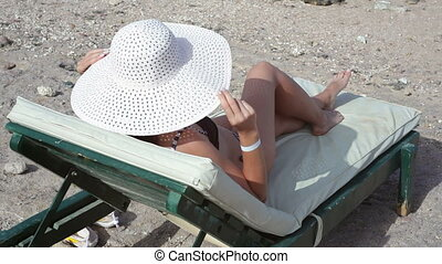 beautiful woman lying on a lounger