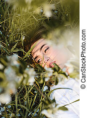 Beautiful woman lying on the grass