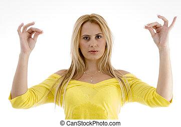 beautiful woman making hand gesture