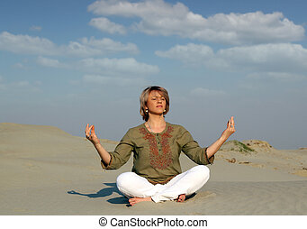 woman meditating in desert