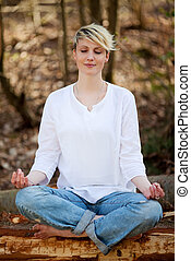 Beautiful Woman Meditating In Forest