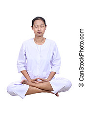 Beautiful woman meditating with eyes closed.