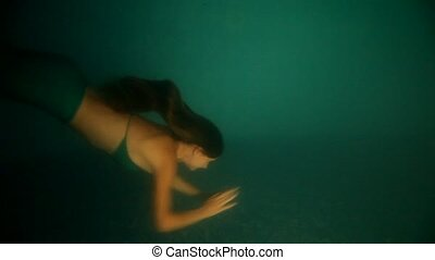 Beautiful woman mermaid diving  and