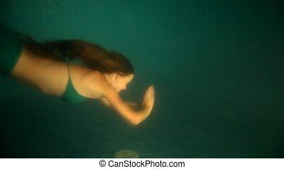 Beautiful woman mermaid diving  and