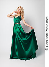 Beautiful woman model posing in green dress