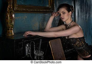 Beautiful woman  near of the piano