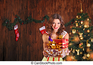 beautiful woman near the Christmas tree