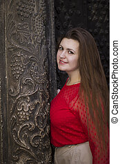 Beautiful woman near the old building in Lviv