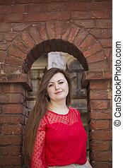 Beautiful woman near the old wall in Lviv