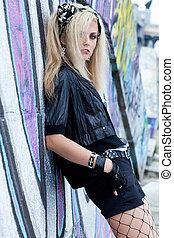 Beautiful woman near the wall