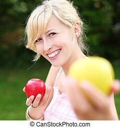 Beautiful woman offering an apple