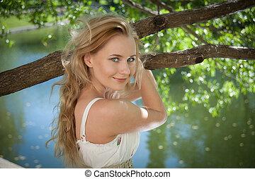 beautiful woman on a background of foliage