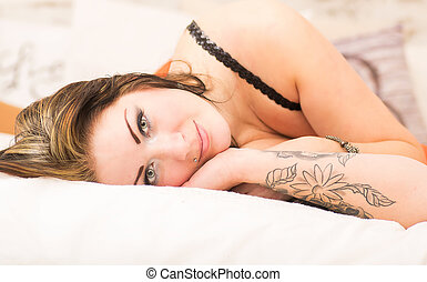Beautiful woman on a bed