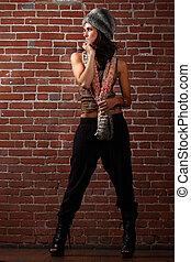 Beautiful Woman on a Brick Background