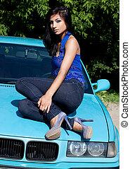 Beautiful woman on a car