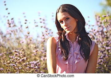 Beautiful Woman on a Field in Summertime