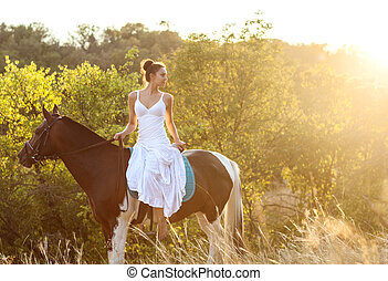 Beautiful woman on a horse. Horseback rider