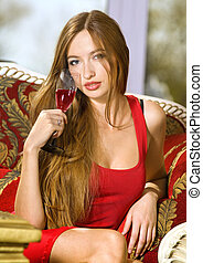 beautiful woman on a sofa with glass