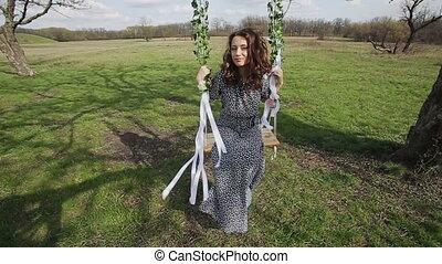 Beautiful Woman on a Swing